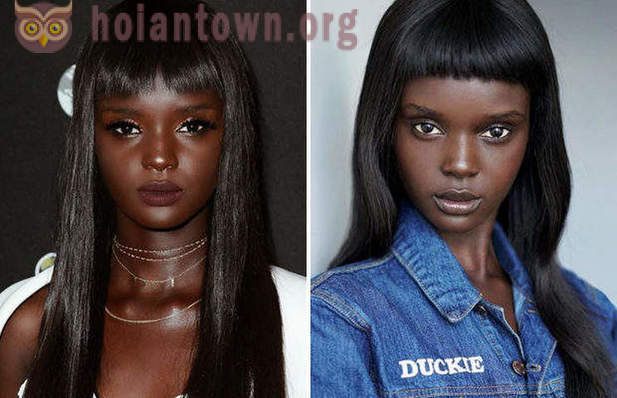 The black model with doll looks
