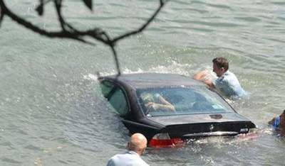 The police rescued the woman in the rapidly sinking BMW